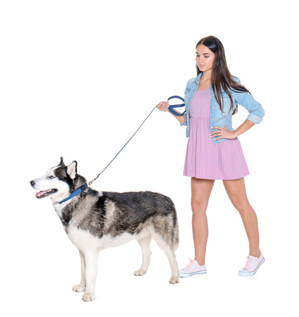 Young woman with cute Husky dog on white background. Pet adoption