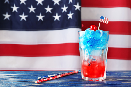 Layered cocktail in colors of American flag on table