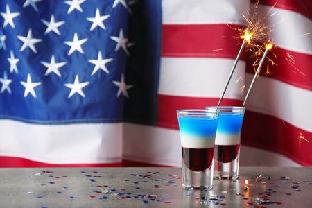 Layered cocktails in colors of American flag on table Stock Photo