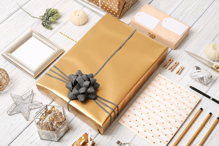 Composition with beautiful gift box and decorations on wooden background