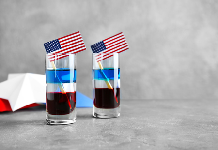 Layered cocktails in colors of American flag on table Banco de Imagens