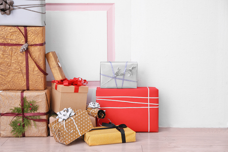 Beautiful gift boxes in front of door indoors Stock Photo