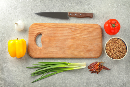 Wooden board and products on grey background. Cooking master classes