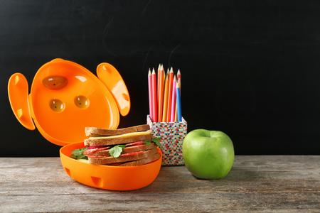 Food for school child in lunch box on dark background Standard-Bild - 112684885