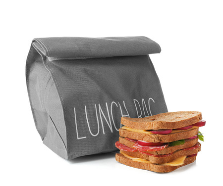 Sandwiches for schoolchild and lunch bag on white background Stock Photo