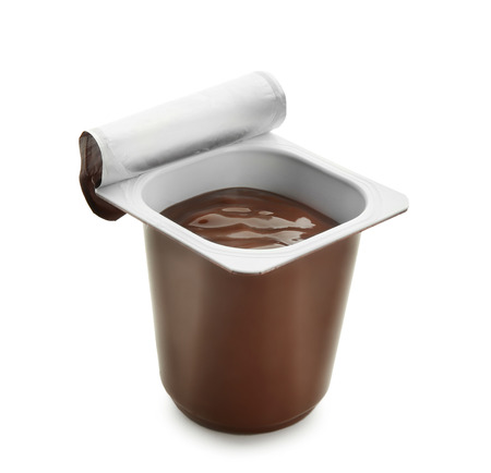Plastic cup with chocolate yogurt on white background