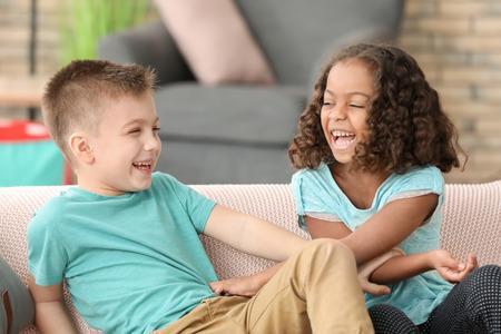 Cute children playing indoors. Child adoption