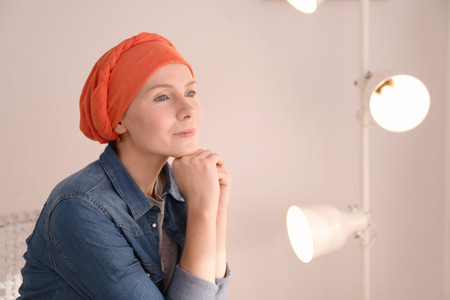 Young woman with cancer in headscarf indoors Archivio Fotografico