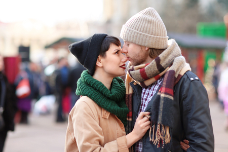 Cute young couple in warm clothes outdoors