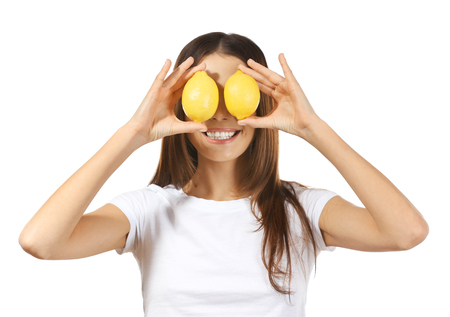Beautiful young woman with ripe lemons on white background 写真素材