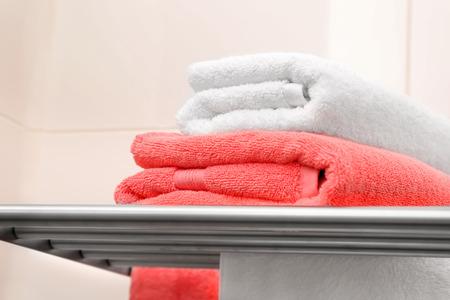 Soft towels on rack indoors