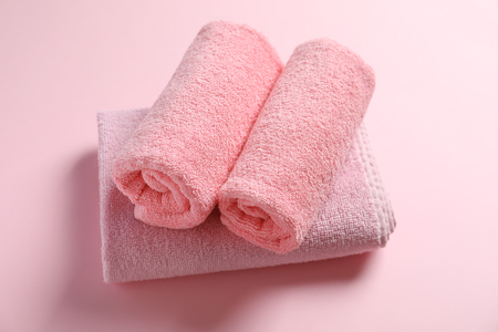 Clean towels on color background