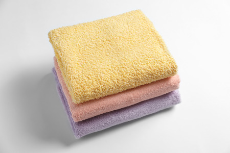 Clean towels on white background 免版税图像