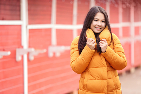 Attractive young woman in warm clothes outdoors