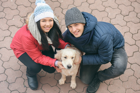 Cute couple with dog outdoors 스톡 콘텐츠