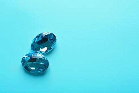 Precious stones for jewellery on color background