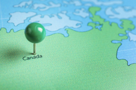 Canada pinned on map, closeup