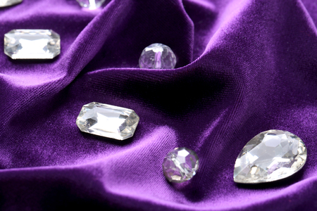 Precious stones for jewellery on purple velvet Stock Photo