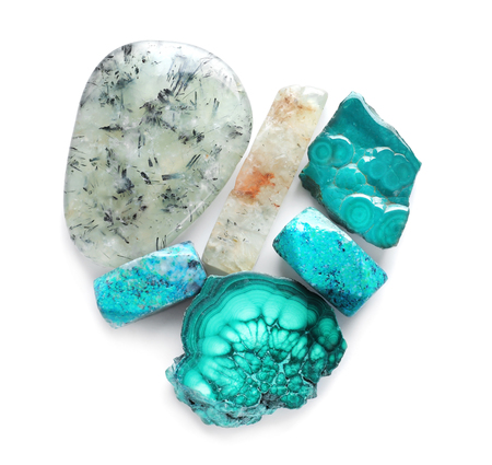 Different natural semi-precious stones for jewellery on white background