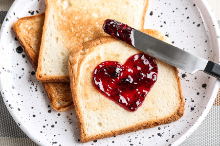 Delicious toast with sweet jam on plate Banco de Imagens