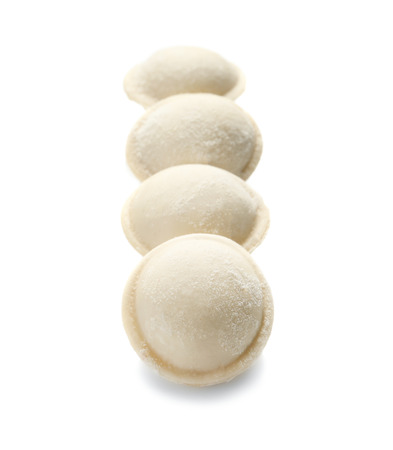 Raw dumplings on white background