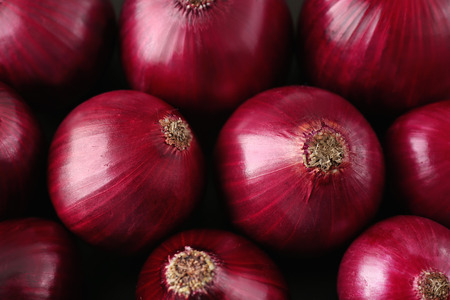 Ripe red onions as background, closeup Stock Photo