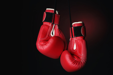 Boxing gloves on dark background