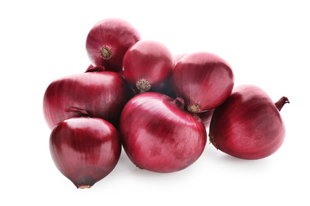 Whole red onions on white background