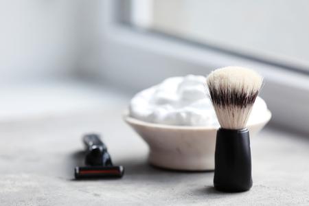 Barber brush, shaving foam and razor for man on table
