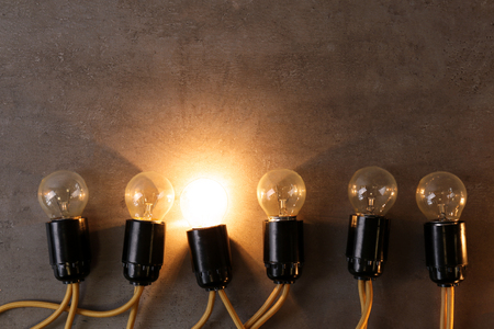 Unique Glowing Light Bulb Among Switched Off Ones Individuality And