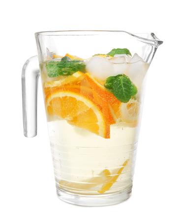 Jug of tasty orange lemonade on white background