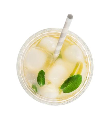 Glass of tasty lemonade on white background