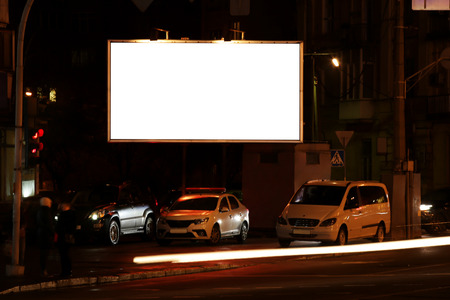 Blank advertisement board on street at night
