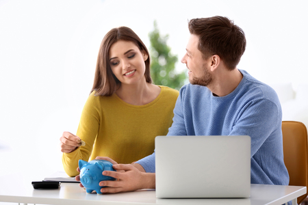 Young couple thinking over pension plan at home Stockfoto