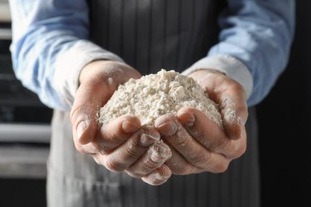 Man holding wheat flour, closeup