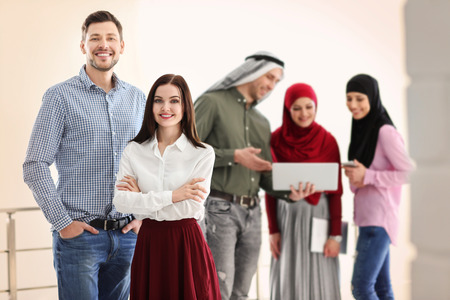 Office employees and their Muslim coworkers in office Stock Photo