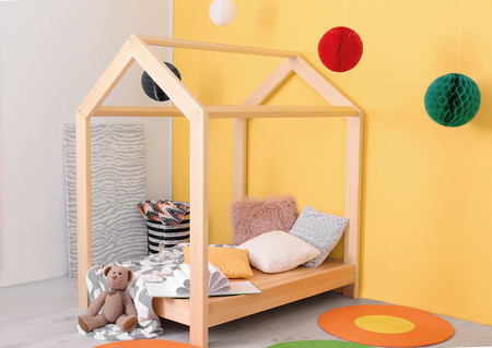 Beautiful children's room interior with wooden bed