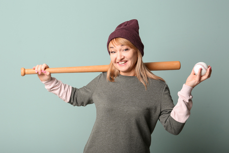 Happy senior woman in hipster outfit on grey background Stock Photo