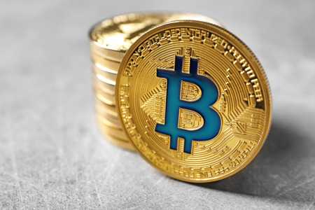 Golden bitcoins on light background. Finance trading