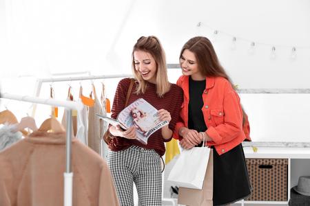 Young beautiful women shopping in store