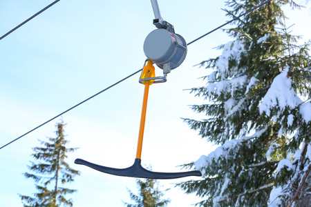 T-bar of ski lift at snowy resort. Winter vacation Banco de Imagens