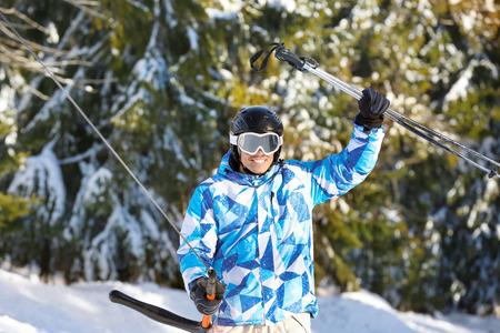 Man using ski lift at snowy resort. Winter vacation Фото со стока