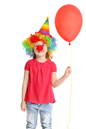 Cute little girl in funny disguise on white background. April fool's day celebration