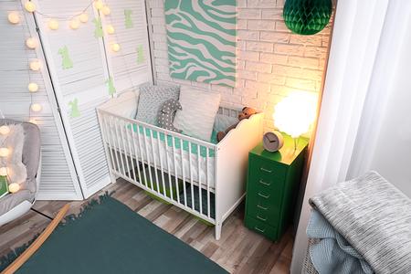 Interior of beautiful modern children's room with crib Archivio Fotografico