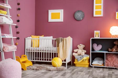 Interior of beautiful modern children's room with crib Stockfoto