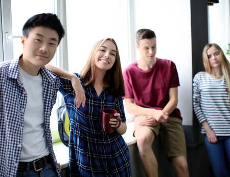 Students resting together in campus building