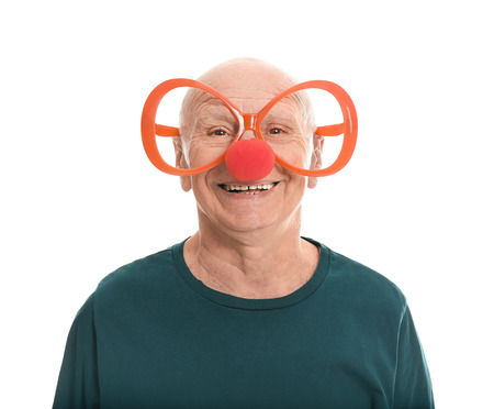 Mature man in funny disguise on white background. April fool's day celebration Banco de Imagens