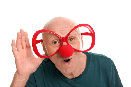 Mature man in funny disguise on white background. April fool's day celebration Stock Photo