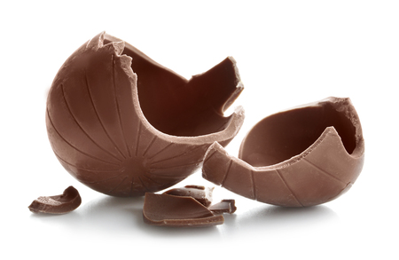 Broken chocolate Easter egg on white background Stock Photo