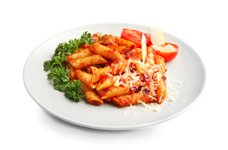 Plate with delicious penne pasta and garnish on white background